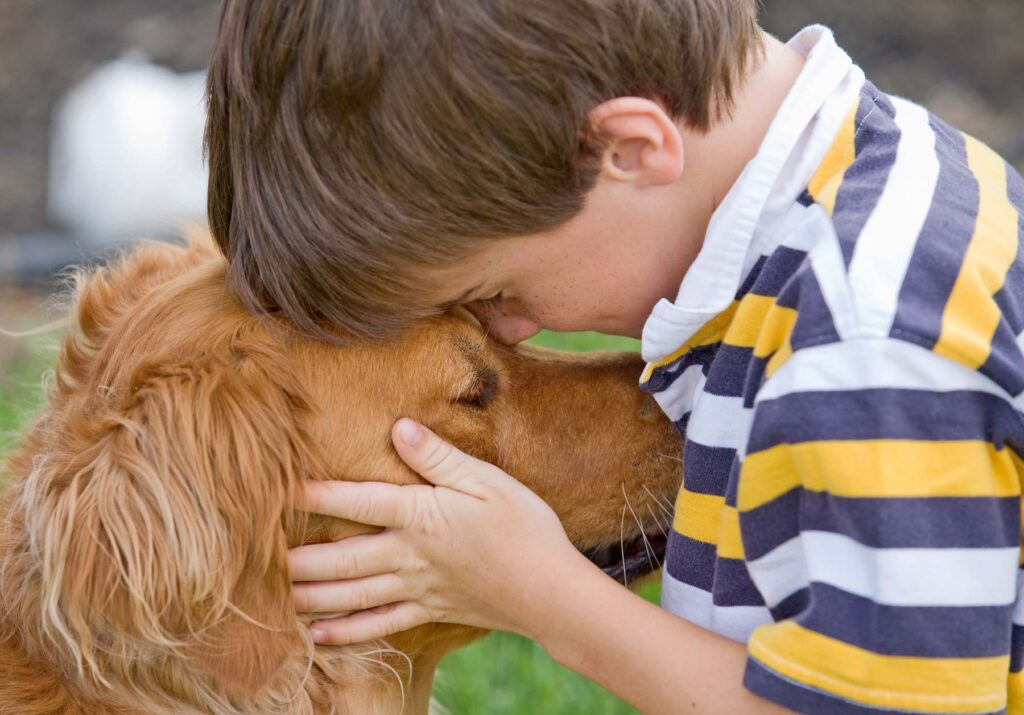 Image of a young boy with his dog